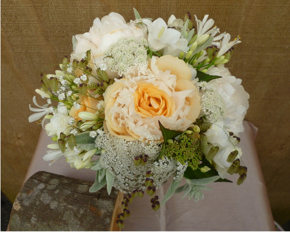 Peach, cream and white soft posy of roses